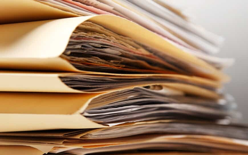 stack of paper documents and files