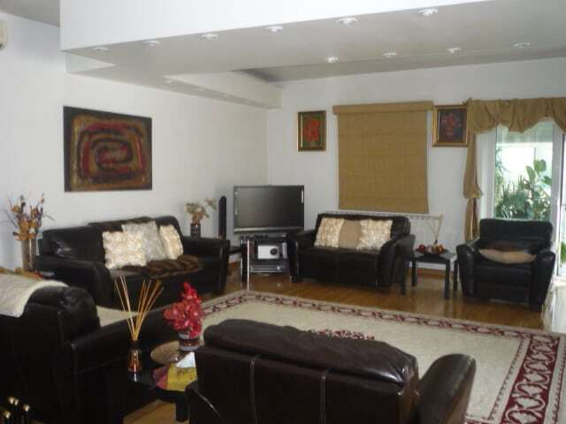 living room with leather sofa and armchairs