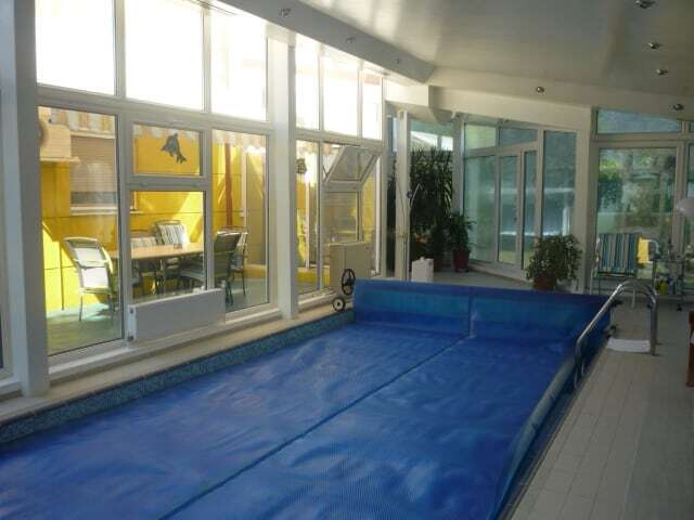 inside pool room with big windows