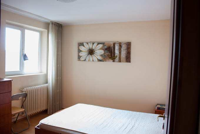 bedroom with a painting on a wall