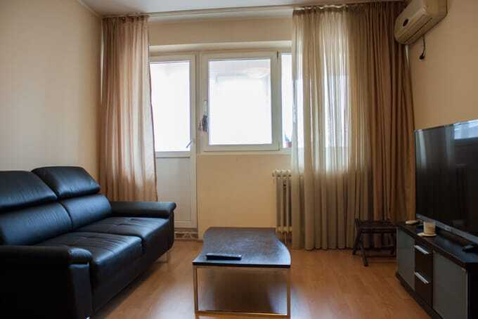 living room with brown curtains
