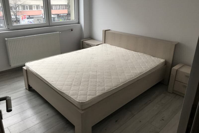 bed with mattress in apartment for rent