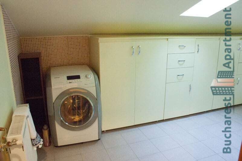 laundry room with washing machine and closets