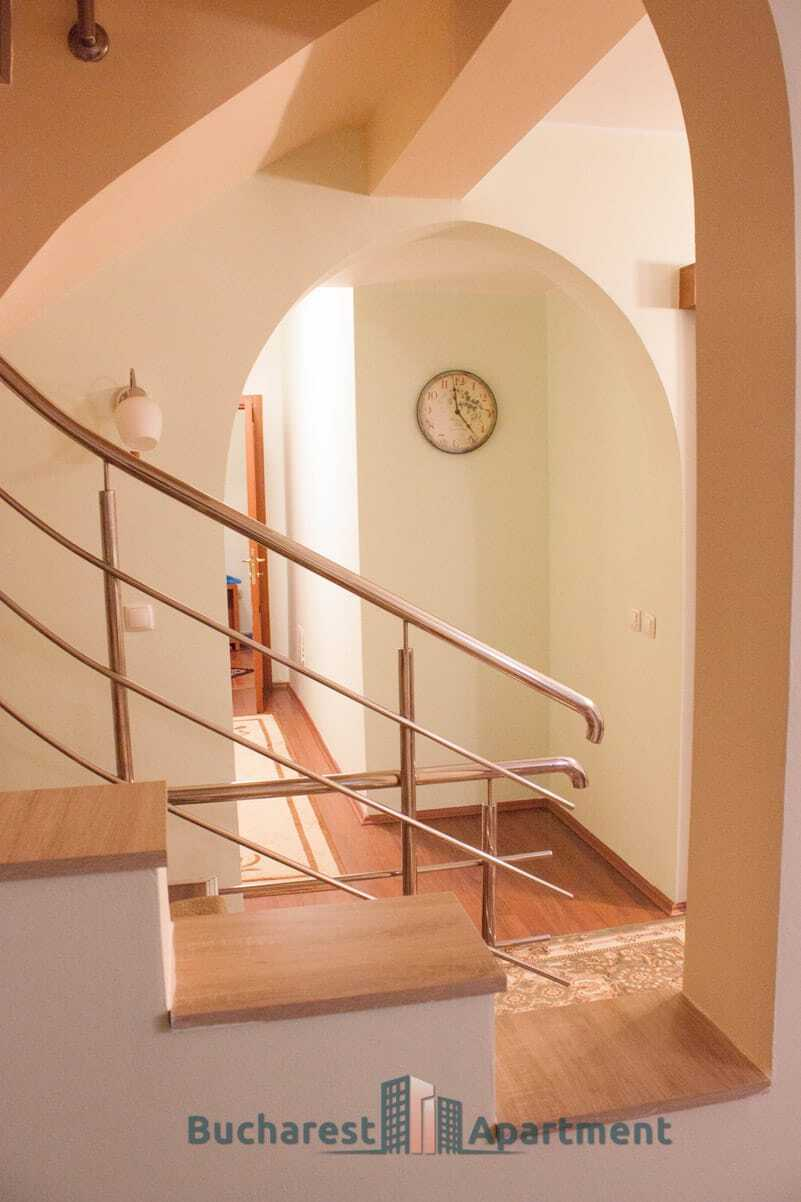 wooden stairs with steel railing
