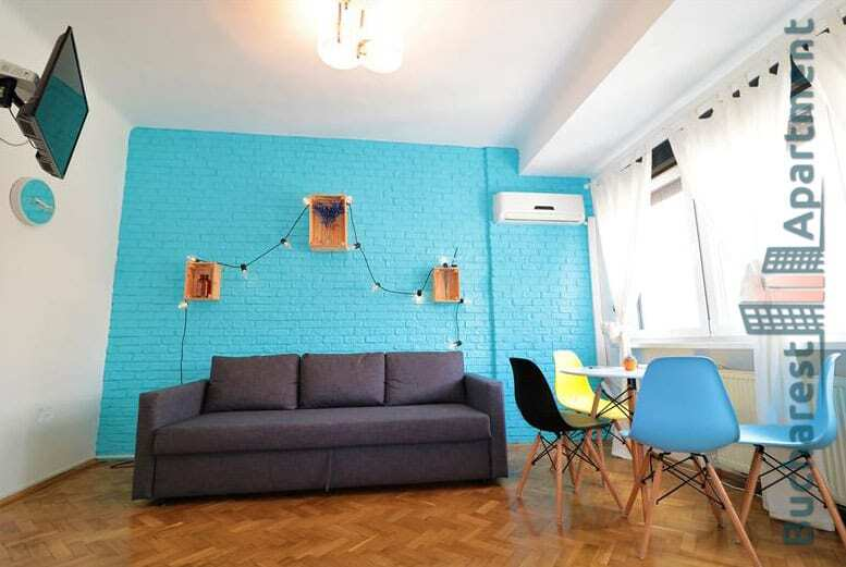 light living room with one blue wall