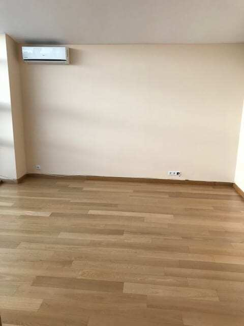 unfurnished bedroom with air conditioner