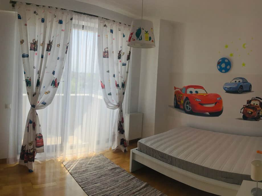 children bedroom with cars wallpaper