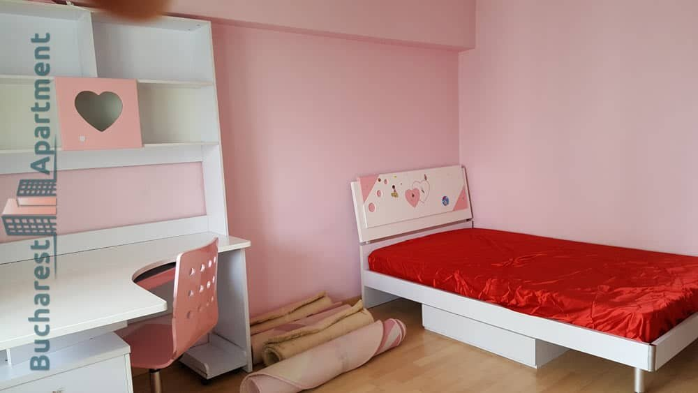 kids room with bed and table