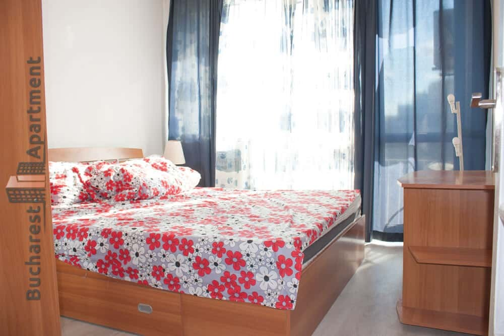 bedroom with floral bed lining