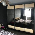 big mirror wardrobe in dark walls bedroom