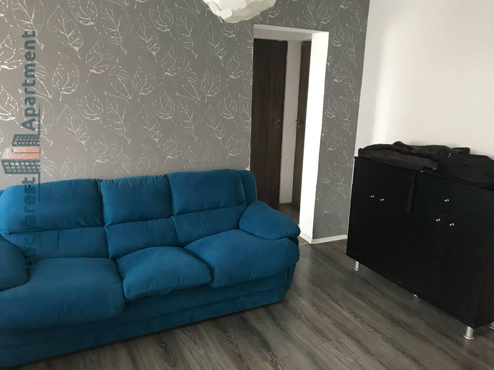 blue couch in grey wallpapers living room