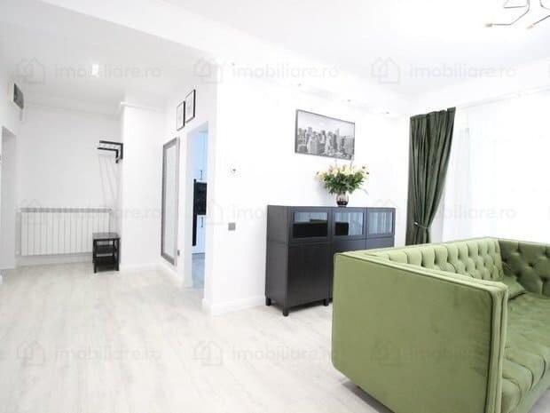 light living room with green sofa
