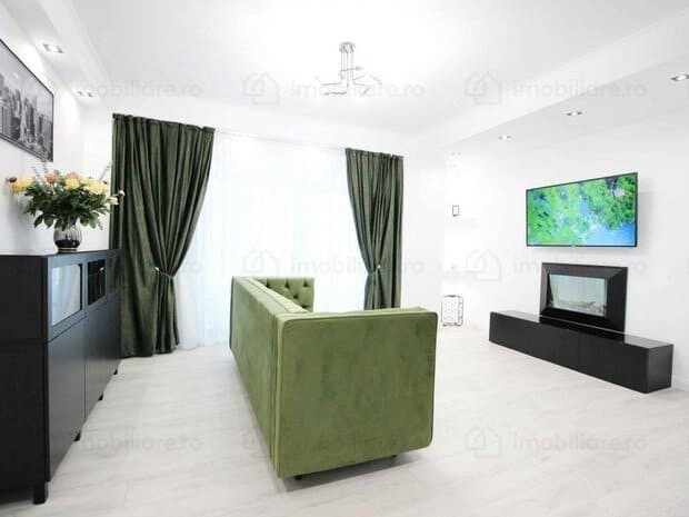white living room with green furniture