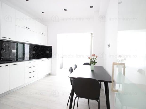 light kitchen with black dining table