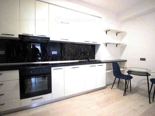 modern white kitchen with black top