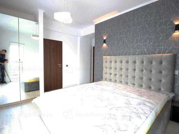 bedroom with grey bed