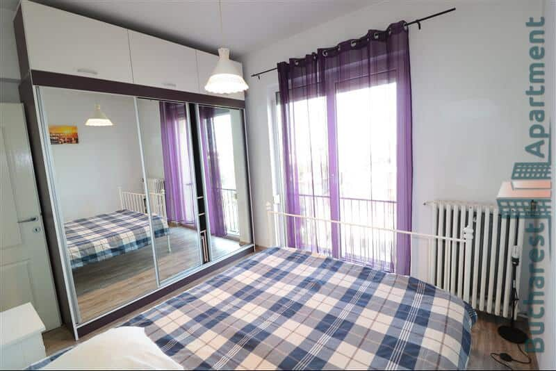 light bedroom with purple curtains