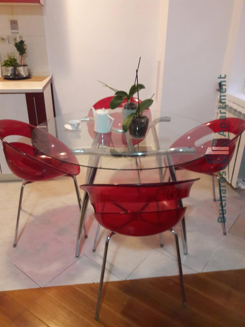 dining area with red plastic chairs