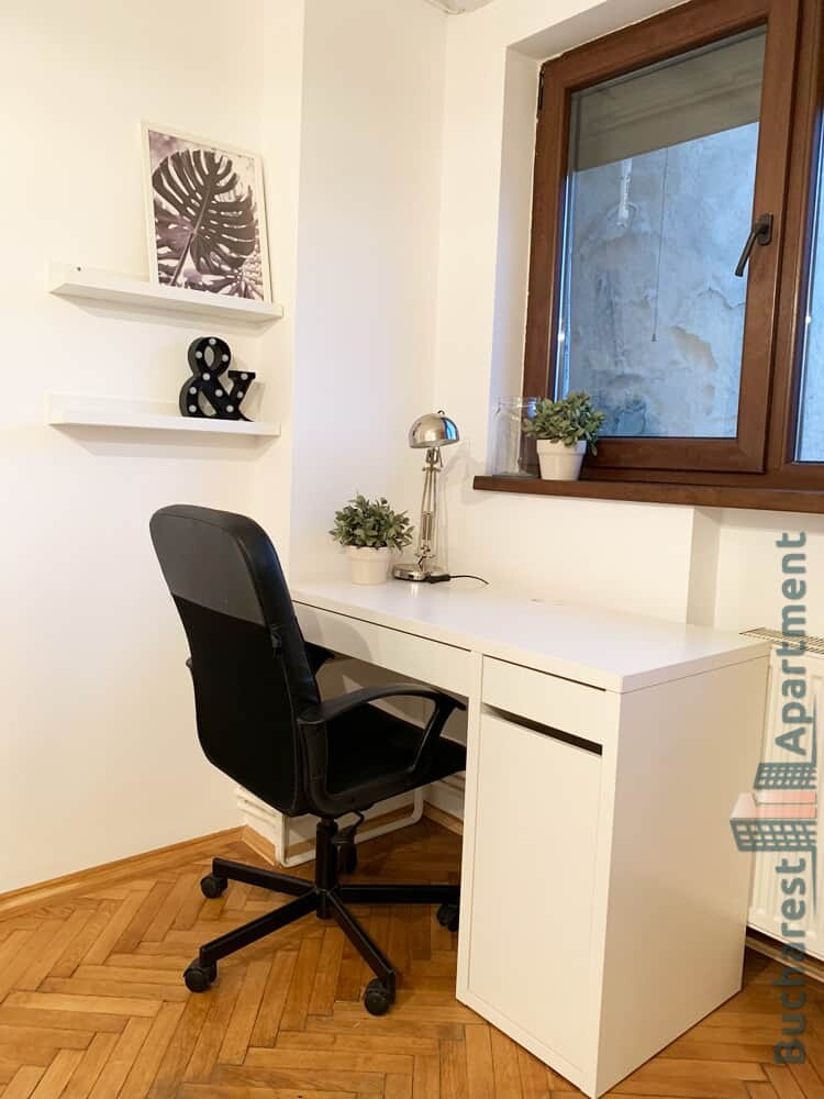 white desk with black chair