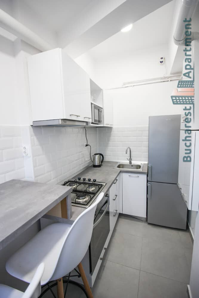 white kitchen with grey top