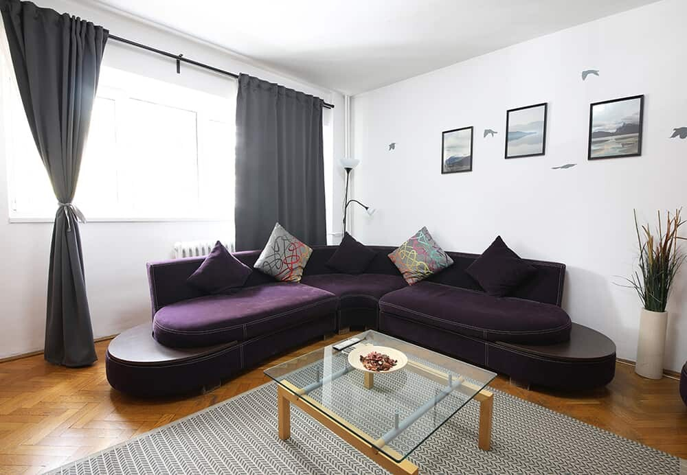 living room with purple couch
